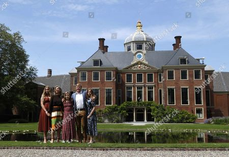 Stock Photo of (L-R) Dutch Princess Catharina-Amalia, Queen Maxima, Princess Ariane, King Willem-Alexander and Princess Alexia pose during the annual royal photo session in the garden of Huis ten Bosch Palace in The Hague, Netherlands, 19 July 2019. Huis ten Bosch is one of three official residences of the Dutch royal family.