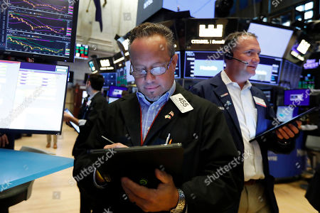 Trader Robert Arciero works on the floor of the New York Stock Exchange, . U.S. stocks moved broadly higher in early trading on Wall Street Friday and chipped away at the week's losses