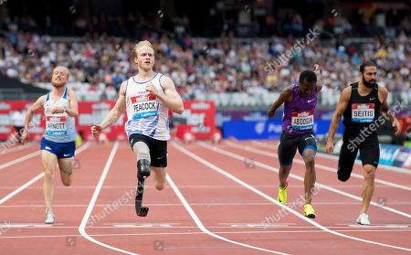 Jonnie Peacock finishes in first position in the Mens T44-64 100m with Ola Abidogun finishing in second for Great Britain