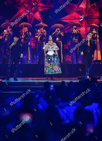 Christian Nodal, Angela Aguilar and Pipe Bueno perform on stage