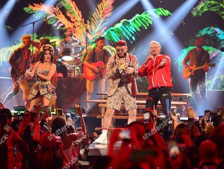 Lali, Farruko and Pedro Capo perform on stage