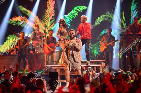 Stock Picture of Lali, Farruko and Pedro Capo perform on stage