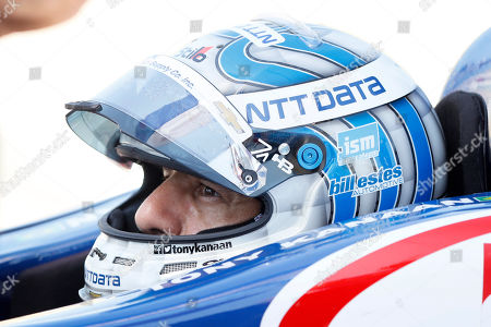 Tony Kanaan sits in his car during practice for the IndyCar Series auto race, at Iowa Speedway in Newton, Iowa