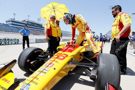 Ryan Hunter-Reay climbs into his car during qualifying for the IndyCar Series auto race, at Iowa Speedway in Newton, Iowa