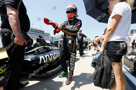 James Hinchcliffe stands next to his car during qualifying for the IndyCar Series auto race, at Iowa Speedway in Newton, Iowa