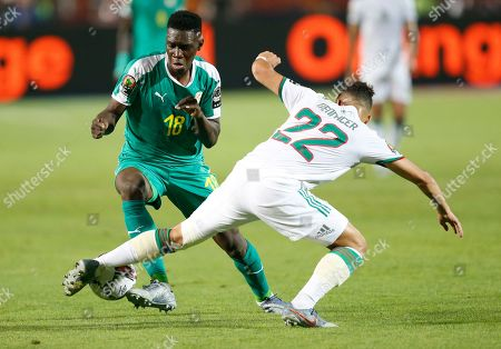 Senegal's Ismaila Sarr, left, and Algeria's Ismael Bennacer fight for the ball during the African Cup of Nations final soccer match between Algeria and Senegal in Cairo International stadium in Cairo, Egypt
