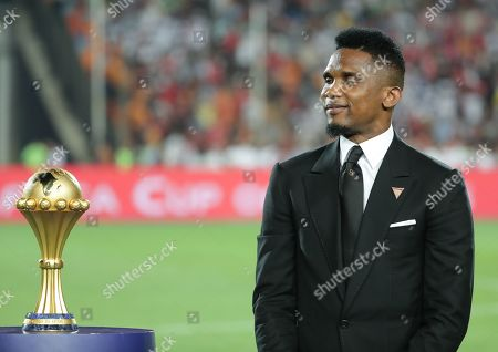 Cameroonian Samuel Eto'o stands next to the Africa Cup of Nations trophy before  the 2019 Africa Cup of Nations (AFCON) final soccer match between Algeria and Senegal at Cairo  Stadium in Cairo, Egypt, 19 July 2019.