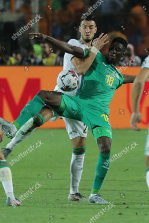Senegal's Ismaila Sarr (R) in action against Algeria's Amir Bensebaini during the 2019 Africa Cup of Nations (AFCON) final soccer match between Algeria and Senegal at Cairo  Stadium in Cairo, Egypt, 19 July 2019.