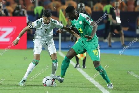 Algeria's Riyad Mahrez in action against Senegal's Ismaila Sarr during the 2019 Africa Cup of Nations (AFCON) final soccer match between Algeria and Senegal at Cairo  Stadium in Cairo, Egypt, 19 July 2019.