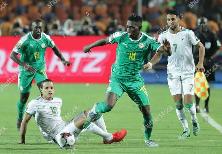 Algeria's Mehdi Zeffane (L) in action against Senegal's Ismaila Sarr during the 2019 Africa Cup of Nations (AFCON) final soccer match between Algeria and Senegal at Cairo  Stadium in Cairo, Egypt, 19 July 2019.