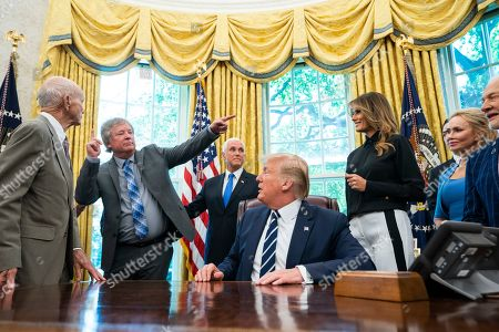 US President Donald Trump welcomes astronauts Buzz Aldrin (R), Michael Collins (L), and Andrew Armstrong (C-L), the son of Neil Armstrong, to the Oval Office honor the 50th anniversary of the Apollo moon landing in the Oval Office of the White House in Washington, DC, USA, 18 July 2019. The president also answered questions about his racist tweet, and the Iranian drone shot down by American forces.