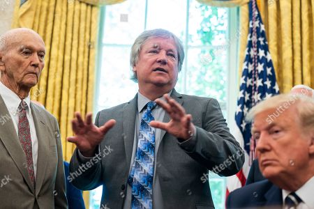 US President Donald J. Trump (R) welcomes astronaut Michael Collins (L), and Andrew Armstrong (C), the son of Neil Armstrong, to the Oval Office honor the 50th anniversary of the Apollo moon landing in the Oval Office of the White House in Washington, DC, USA, 19 July 2019. The president also answered questions about his racist tweet, and the Iranian drone shot down by American forces.