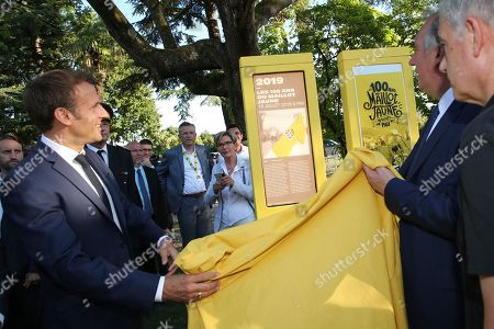 Stock Image of French President Emmanuel Macron (L) unveils a totem with Pau mayor Francois Bayrou (R) during a ceremony to mark the 100th anniversary of the Tour de France yellow jersey in Pau, France, 19 July 2029.