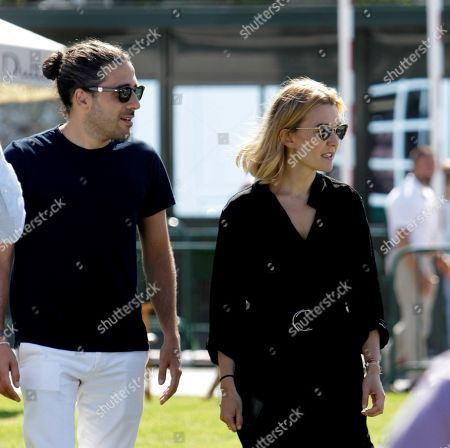Inditex founder Amancio Ortega's daughter Marta Ortega (R) and husband Carlos Torretta (L) attend the opening of the 38th International Jumping Competition in A Coruna, northwestern Spain, 19 July 2019. The competition will take place in summer at Casas Novas' hippodrome.