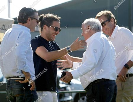 Inditex founder Amancio Ortega (2-R) and son-in-law Carlos Torretta (2-L) attend the opening of the 38th International Jumping Competition in A Coruna, northwestern Spain, 19 July 2019. The competition will take place in summer at Casas Novas' hippodrome.