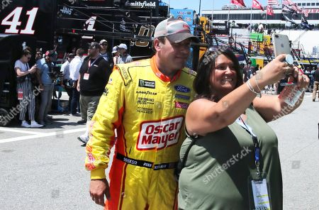 Ryan Newman poses for a selfie with a fan prior to a NASCAR Cup Series auto race practice at New Hampshire Motor Speedway in Loudon, N.H