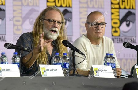 """Greg Nicotero, Michael Satrazemis. Greg Nicotero, left, and Michael Satrazemis participate in a """"Fear The Walking Dead"""" Panel on day two of Comic-Con International, in San Diego"""