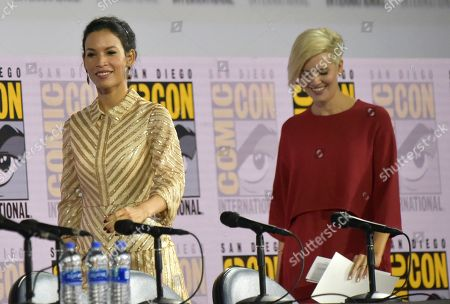 """Danay Garcia, Maggie Grace. Danay Garcia, left, and Maggie Grace walk on stage at a """"Fear The Walking Dead"""" Panel on day two of Comic-Con International, in San Diego"""