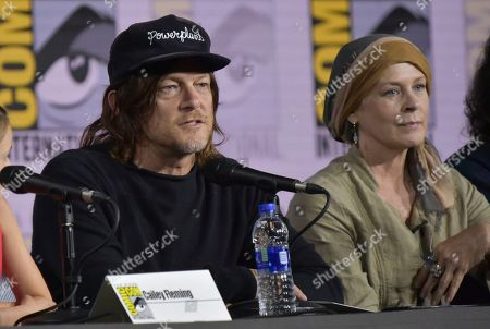 """Norman Reedus, Melissa McBride. Norman Reedus, left, and Melissa McBride participate in """"The Walking Dead"""" panel on day two of Comic-Con International, in San Diego"""