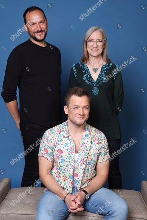 "Louis Leterrier, Taron Egerton, Lisa Henson. Louis Leterrier, from left, Taron Egerton and Lisa Henson pose for a portrait to promote ""The Dark Crystal: Age of Resistance"" on day two of Comic-Con International, in San Diego"