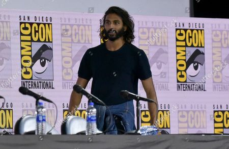 "Avi Nash walks on stage at ""The Walking Dead"" panel on day two of Comic-Con International, in San Diego"