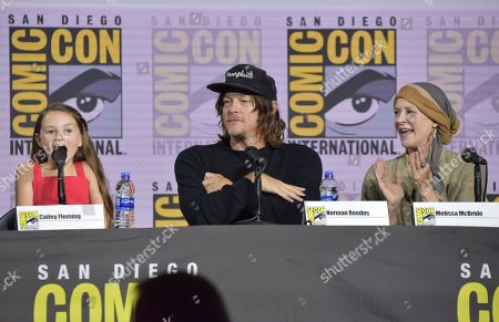 """Cailey Fleming, Norman Reedus, Melissa McBride. Cailey Fleming, from left, Norman Reedus and Melissa McBride participate in """"The Walking Dead"""" panel on day two of Comic-Con International, in San Diego"""