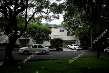 Cars drive past the home of former first lady Angelica Rivera, in the Lomas de Chapultepec neighborhood of Mexico City, . A gang of at least seven gunmen burst into the Mexico City home of the former first lady and forced employees to hand over valuables