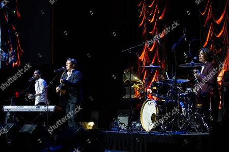 Stock Image of (L-R) Singers Taylor Hanson, Isaac Hanson, and Zac Hanson of Hanson perform onstage during the Texas Chapter of the Recording Academy's 25th Anniversary Gala at ACL Live.