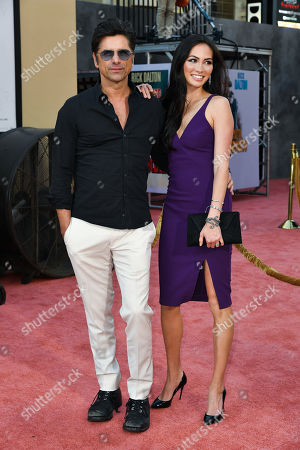 Stock Picture of John Stamos and Caitlin McHugh