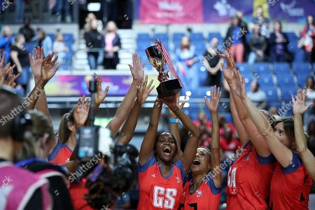Oti's Warriors celebrate victory after the Sport Relief celebrity match - Otlile Mabuse with trophy