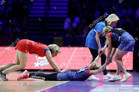 Sally Phillips is pulled along the court by Jennifer Saunders  during the Sport Relief celebrity match