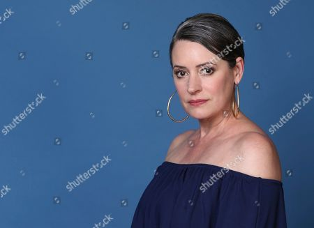"""Paget Brewster poses for a portrait to promote the animated television series """"DuckTales"""" on day two of Comic-Con International, in San Diego"""
