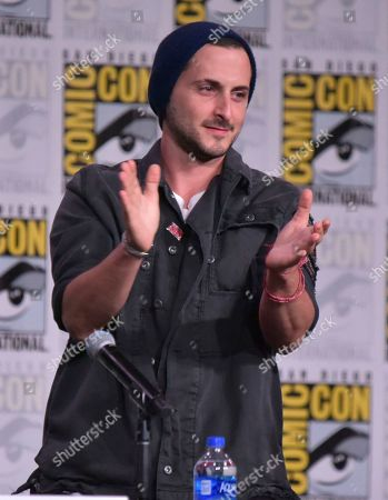 """Tomer Kapon gestures as he walks on stage at """"The Boys"""" panel on day two of Comic-Con International, in San Diego"""