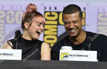 """Maisie Williams, Jacob Anderson. Maisie Williams, left, and Jacob Anderson appear during the """"Game of Thrones"""" panel on day two of Comic-Con International, in San Diego"""