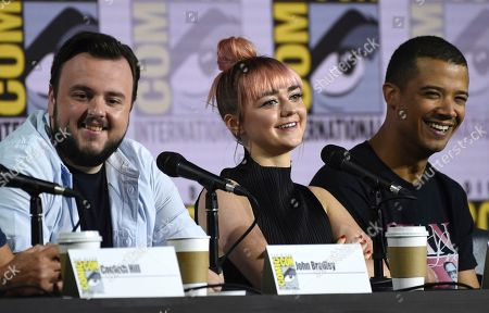 """Maisie Williams, Jacob Anderson. John Bradley, from left, Maisie Williams, and Jacob Anderson appear during the """"Game of Thrones"""" panel on day two of Comic-Con International, in San Diego"""