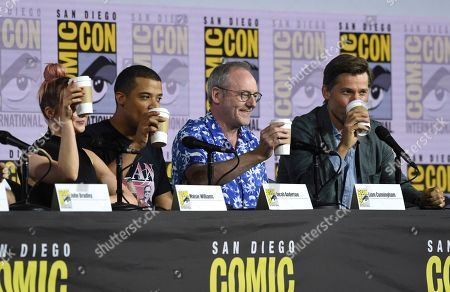 """Maisie Williams, Jacob Anderson, Liam Cunningham, Nikolaj Coster-Waldau. Maisie Williams, from left, Jacob Anderson, Liam Cunningham and Nikolaj Coster-Waldau appear at the """"Game of Thrones"""" panel on day two of Comic-Con International, in San Diego"""