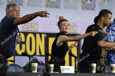 """Conleth Hill, Maisie Williams, Jacob Anderson. Conleth Hill, from left, Maisie Williams and Jacob Anderson throw their name card to the audience at the conclusion of the """"Game of Thrones"""" panel on day two of Comic-Con International, in San Diego"""