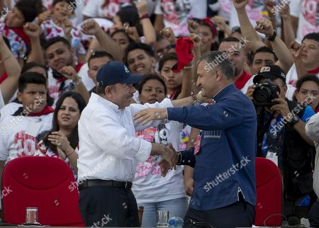 Nicaraguan President Daniel Ortega (L) and  President of South Ossetia Anatoli Bibilov (R) participate in the commemoration of the 40th anniversary of the Nicaraguan Revolution at Faith Square in Managua, Nicaragua, 19 July 2019.