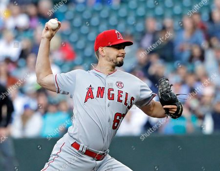 Los Angeles Angels starting pitcher Taylor Cole throws against the Seattle Mariners during the first inning of a baseball game, in Seattle