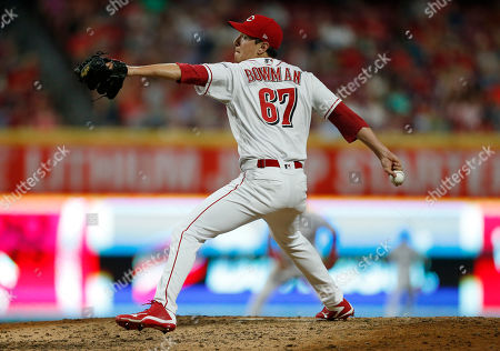 Stock Picture of Cincinnati Reds relief pitcher Matt Bowman (67) throws against the St. Louis Cardinals during the sixth inning of a baseball game, in Cincinnati