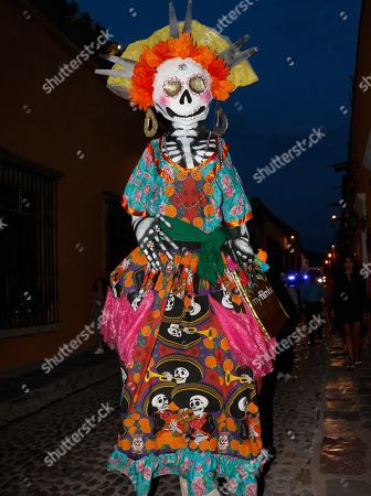 People parade with figures as a tribute to the film career of Mexican actor Jose Carlos Ruiz, during the inauguration of the Guanajuato International Film Festival (GIFF) 2019, in San Miguel de Allende, Guanajuato, Mexico, 19 July 2019.