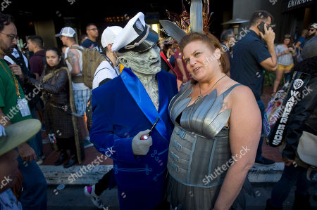 Ann Hampshire (C, right), who is dressed as Game of Thrones character, chats with her husband Jim Hampshire (C, left), who is dressed as Hugh Hefner, during a Playboy inspired Game of Thrones photo shoot at Comic Con International in San Diego, California, USA, 19 July 2019.