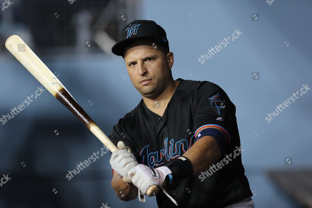 Miami Marlins first baseman Martin Prado (14) warms up in the dugout during the game between the Miami Marlins and the Los Angeles Dodgers at Dodger Stadium in Los Angeles, CA. (Photo by Peter Joneleit)