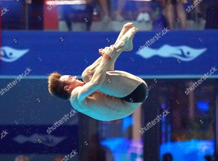 Thomas Daley of Britain performs during the men's 10m Platform Diving final of the FINA Swimming World Championships 2019 at the Yeomju gym in Gwangju, South Korea, 20 July 2019.