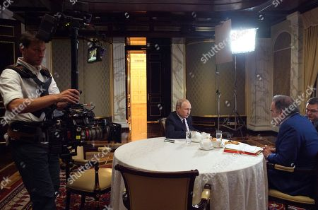 Oliver Stone (R) interviews Russian President Vladimir Putin for his Revealing Ukraine documentary at the Kremlin in Moscow, Russia, late 19 July 2019.
