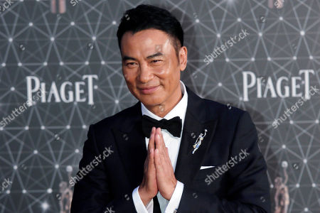 Taken, Hong Kong actor Simon Yam poses on the red carpet of the Hong Kong Film Awards in Hong Kong. Yam was stabbed Saturday, July 20, 2019 while attending an event in southern China