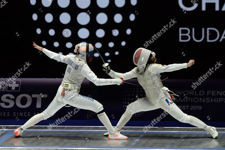 Inna Deriglazova of Russia, left, and Pauline Ranvier of France compete during the  Women's Foil final match at SYMA Sports and Conference Centre