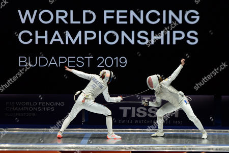 Stock Image of Inna Deriglazova of Russia, left, and Pauline Ranvier of France compete during the  Women's Foil final match at SYMA Sports and Conference Centre