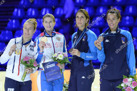 Champion Inna Deriglazova of Russia, second left, second place Pauline Ranvier of France, left, third place Arianna Errigo of Italy, second right and Elisa Di Francisca of Italy during the  Women's Foil medal ceremony at SYMA Sports and Conference Centre