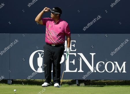 Thailand's Kiradech Aphibarnrat acknowledges the crowd as he prepares to play the 1st tee during the third round of the British Open Golf Championships at Royal Portrush in Northern Ireland